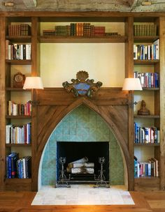 French Country Cottage Fireplace: The light scones are attached right onto the facade & there are surrounding built-in shelves. Design by Barnes Vanze Architects