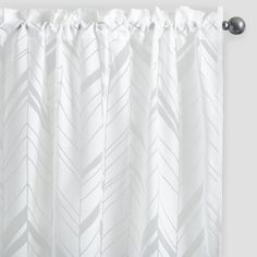 Featuring a chevron arrow burnout design on a white background, our sheer curtains are soft, lightweight and perfect for letting sunlight filter through.