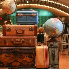 See the details that were part of our travel theme wedding, and get some inspiration for your own! Vintage globes, suitcases and maps- we had it all!