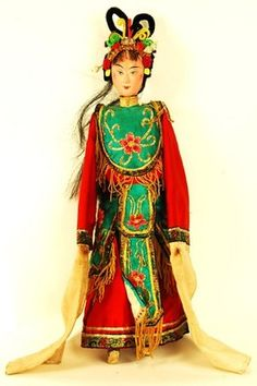 Once the primary form of entertainment, Chinese Opera dolls like this one, featuring the Dan, or female character, each have an extreme level of detail put both into the face as well as the robes.