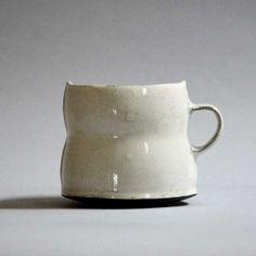 birdie boone -Handbuilt dark chocolate stoneware with white bisque slip and studio-made glaze