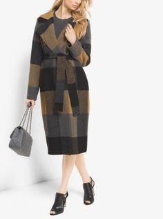 Cut from a rich blend of wool-blend, this enveloping wrap coat is updated in a…