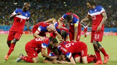The United States team surrounds John Brooks after he scored his side's second goal to defeat Ghana 2-1 during the group G World Cup soccer match between Ghana and the United States at the Arena das Dunas in Natal, Brazil, Monday, June 16, 2014. (AP Photo/Julio Cortez)