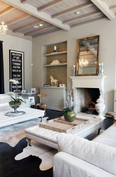 Lucy and Company: Chic living room with vintage subway sign and gray living room walls paint color. Gray ...