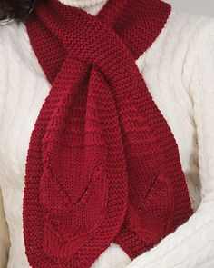 Free Knitting Pattern for Beginner Keyhole Scarf - This beginner pattern by Ann Regis features easy garter stitch sections and ends with heart / flower shaped motifs at the ends.