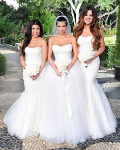 The 50 most iconic wedding gowns in history kate moss wedding august 2011 wedding to kris humphries kim kardashian decked her bridesmaid sisters khloe and kourtney in their own white vera wang gowns junglespirit Gallery