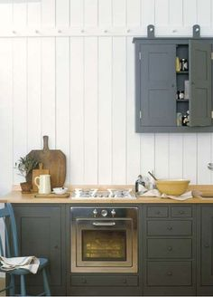 Upper cabinets on pegs; a pretty genius nod to a Shaker kitchen.