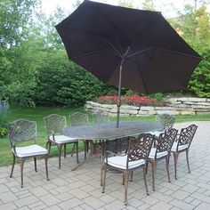 Mississippi 9 Piece Dining Set with Cushions and Umbrella Umbrella Color: Brown, Outdoor Furniture Sets, Patio Dining Sets, Outdoor Dining Table, Pool Furniture Outdoor Dining Set, Patio Dining, Outdoor Decor, Dining Chairs, Dining Table, 3 Piece Bistro Set, 3 Piece Dining Set, Dining Sets, Patio Bar Set