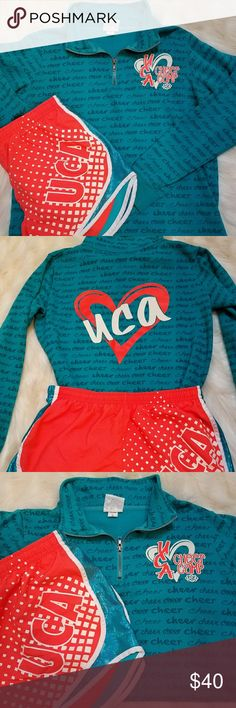Varsity UCA Cheer Camp Set Official Varsity Camp gear from UCA! So cute! Shorts have sparkle inserts (see pic) and are size Medium. Zip up has logo on back (see pic) and is size Small. Great deal & perfect for practice & warm ups! Non smoking. Varsity Tops Sweatshirts & Hoodies