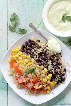 Get in better shape and lose weight by eating this lean Southwestern Quinoa Salad with Creamy Avocado Dressing Recipe. Re-pin now, eat it later.