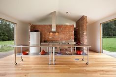 Industrial island on casters for the open kitchen in Melbourne [Design: Maxa Design]