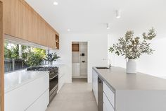 Recent Projects including our latest full design, build and interior design of our small lot block on the Sunshine Coast. Stone Benchtop Kitchen, Timber Kitchen, Concrete Kitchen, Caesarstone Raw Concrete, Living Room Kitchen, Home Decor Kitchen, Home Kitchens, White Wood Kitchens, Gray And White Kitchen