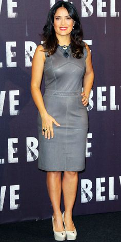 Salma Hayek Pinault posed at a Rome photo call for The Savages in a curve-hugging leather sheath and peep-toe Sergio Rossi pumps.