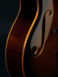 Beautiful binding and F-holes on an archtop guitar by Theo Scharpach.