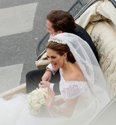 Princess Madeleine of Sweden and Christopher O'Neill sit in the royal horse carriage which carried them in a cortege around the city after their wedding at The Royal Palace Chapel on 8 June 2013 in Stockholm, Sweden
