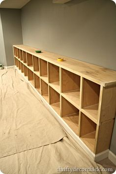 Mmm..I love storage spaces. Could almost use this as a dresser for the kids, they could see what they want easily, without digging through drawers and pulling down on drawers. I'd be fine with no dressers. LOOKS easy enough. Build it, paint, add trim.