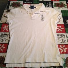 "Women's Ralph Lauren Polo Rugby Short sleeve Polo Super Nice Ralph Lauren Polo Rugby short sleeve Half button top. In excellent condition!! Called the ""Skinny Polo"" these are expensive shirts New! Color white,Size M but runs a lil small. No stains or rips. Minimal use Ralph Lauren Tops"