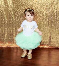 First Birthday Outfit Girl, Mint Gold Tutu Girl First Birthday Outfit, Birthday Shirt, Mint Birthday Tutu, Cake Smash Outfit Dress This First Birthday Girl Outfit including a mint tutu, birthday girl shirt and gold bow is the perfect outfit for her first birthday party or cake smash and is sure to have everyone asking you where you got this precious outfit.   We use a soft high-quality unisex kids onesie with metallic gold text. This tutu is a gorgeous mint color made with 10 layers of soft…