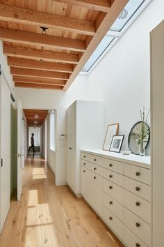 This master bedroom has its own vestibule with plenty of storage, and a skylight adds some natural light to the area.