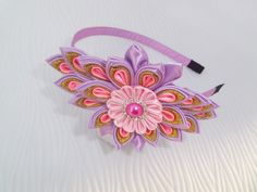 Delicate headband of satin ribbons and brocade adorn a girl, a teenager or young woman.  The work is done in the Japanese art of origami ribbons ( fabric), style Tzoumaz kanzashi .  The headband of metal - lined with satin. The diameter of the flower in the middle is 7 cm ( 2.75 ) the length of the whole flower arrangement of 13 cm ( 5.12 )  My fabric flowers can be a gift for your family and friends!  To see more products, please visit my store: https://www.etsy.com/shop&#x2F...