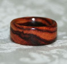 Wood Ring  Wide Brazilian Tulipwood by MnMWoodworks on Etsy.