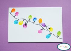 Thumbprint Christmas Lights on a card.