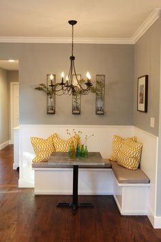 Very sweet little diy nook area... great for a game room or family room too!   Product info: Chandelier-Shades of Light, Pillows- Villas Pillows    Paint Color: Sherwin Williams Uncertain Gray  with Pure White trim