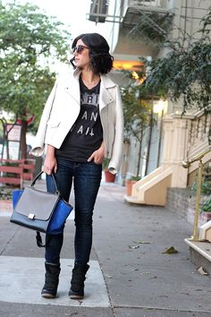 white moto jacket paired with sneaker wedges
