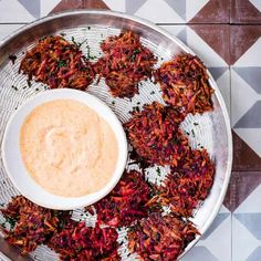 Spiced root vegetable fritters with harissa and lime yogurt