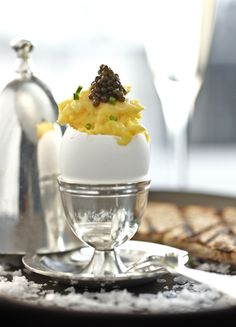 rom Bon Appetit, Jean-Georges Vongerichten smooth scrambled eggs with creme fraiche and caviar, obviously served with a glass of champagne