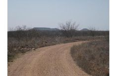 Price Reduced over $100,000 –332 acres Stonewall Co w/home/cabin w/Minerals, Acreage: 332  Price: $385000