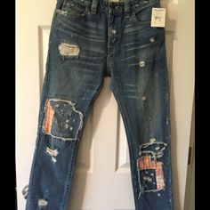 NWT Free People destroyed jeans 27 These jeans are new with tag Size 27 X 30 Cute patched destroyed jeans. The kind your mother will Love Light Wash Free People Jeans Straight Leg