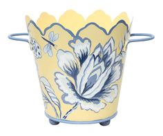 This lovely cachepot features a hand painted design on each side and metal handles. The pot measures approximately 6.3