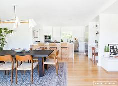 Minimalist Mid-Century Dining room with view into kitchen
