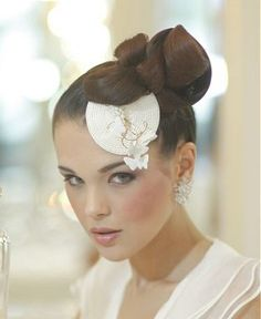 A medium brown straight sculptured wedding updo bride bridal fascinator hairstyle by Bundy Bundy