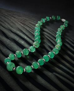 An art deco emerald bead, onyx and diamond necklace, Cartier, COVER
