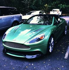 """2014 Aston Martin Vanquish Volante. Emerald Green is my Favorite Color; however, I don't think this car is that color but close enough. I do not even know what kind of a car this is but is looks """"Cool"""" and """"Expensive"""". So if you got one for this """"Redhead,"""" my Irish blood is accepting. ❤︎slcj❤︎♐︎"""
