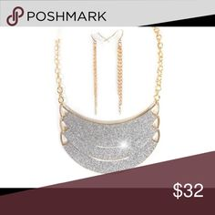 """Coming soon! Silver glittery accent necklace. Silvery glitter accents the 4 1/2"""" wide triple crescents of this designer-style 18"""" adjustable goldtone necklace with matching pierced wire earrings. Jewelry Necklaces"""