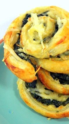 Cheesy Kale Puff Pastry Pinwheels... Ain't nobody parties like kale eaters... And these are great as a change of pace SUPER BOWL PARTY snack... Cheese, nuts, kale and delicious.  You may convert a wing eater or two with these!