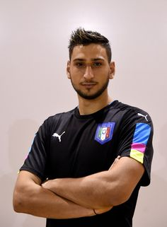 Gianluigi Donnarumma Photos Photos - Gianluigi Donnarumma of Italy poses during the official portrait session prior to the training session at the club's training ground at Coverciano on August 30, 2016 in Florence, Italy. - Italy Training Session And Press Conference