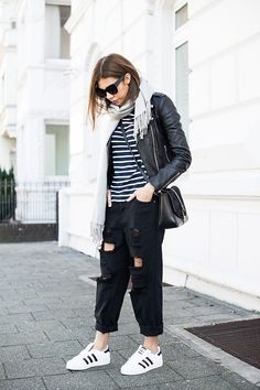 Adidas, a striped shirt, and wide distressed pants: | 29 Looks For Women Who…