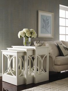 American Treasures ® Nest of Tables – This new nest of tables has a sweeping arch perched panel design on three sides for a fabulous classic, contemporary look. Shown in Antique White.