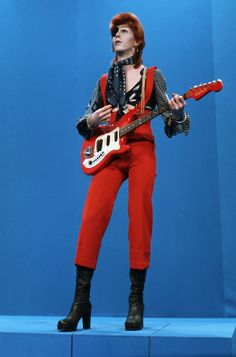 Ziggy played guitar, jammin' good with Weird and Gilly and The spiders from Mars. He played it left hand but made it too far Became the special man, then we were Ziggy's band. Angela Bowie, David Jones, Diamanda Galas, Duncan Jones, Beautiful Men, Beautiful People, Pretty People, Ziggy Played Guitar, David Bowie Ziggy