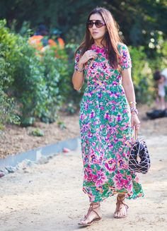 A maxi dress in an abstract, bright pattern and leather accessories