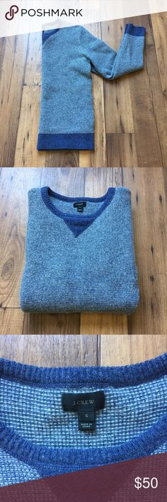 J. Crew 100% Pure Wool Sweater This fantastic sweater from J. Crew features 100% pure wool material. It has beautiful gray and blue hues, with the darker blue outlining the wrists, neckline and waistline. Great quality sweater! J. Crew Sweaters Crew & Scoop Necks