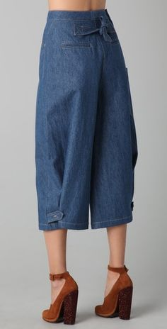 "These denim gaucho pants feature 5-pocket styling and a single-button closure. Patch side pocket. Tie at back and button-tabs at hem.  * 13"" rise. 20"" inseam. * 28"" leg opening."