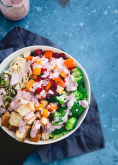 Maple syrup roasted cranberries and butternut squash are added to this fall inspired broccoli salad with toasted croutons, almonds and pepitas.