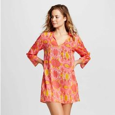 Citron yellow and rich coral come together to make a coverup that is super chic. | CoastalLiving.com