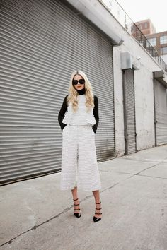 Layer your warm-weather pieces with your winter staples for a chic transitional weather look like Blair Eadie of Atlantic-Pacific in the Tibi Ribbon Fil Coupe Peplum Top and Culottes.