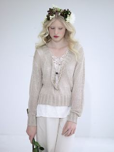 knit sweater and lacy blouse